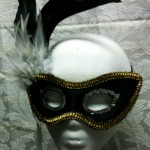 black_with_gold_trim_and_feathers